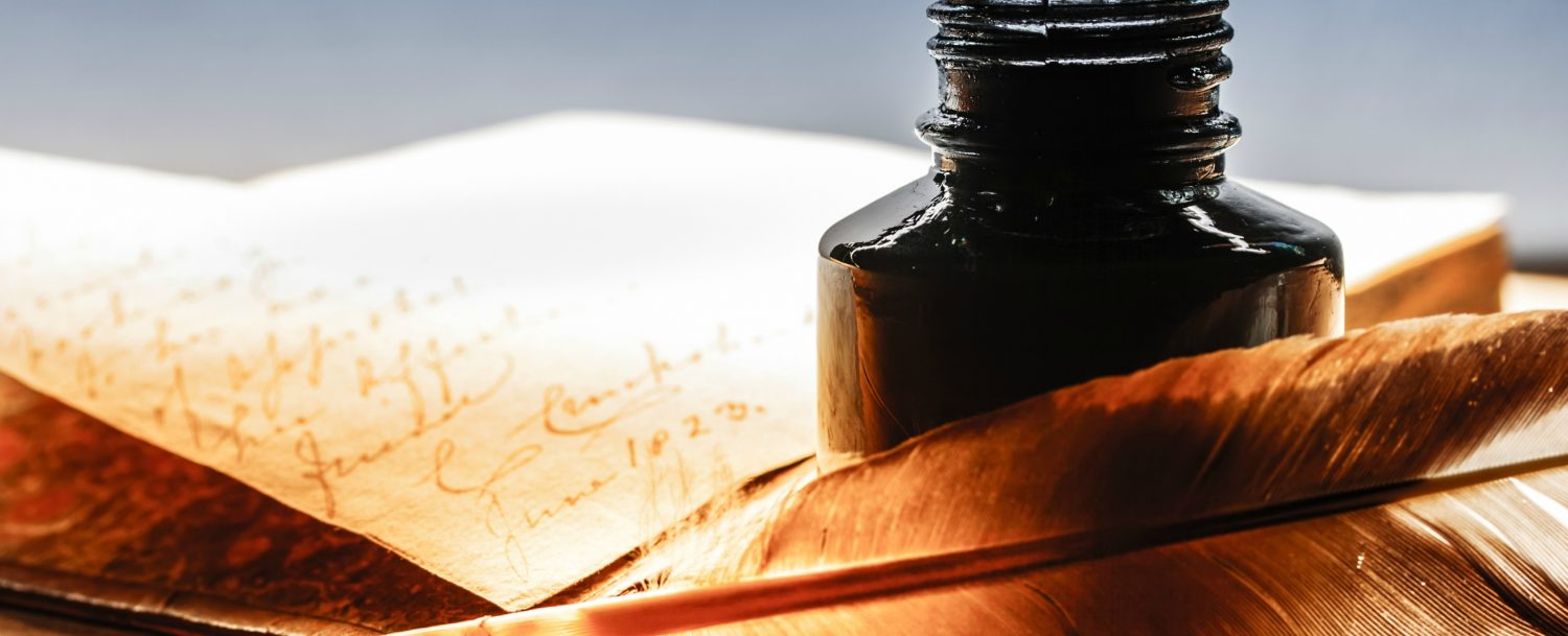 Abram's Delight | Old book with feather pen and inkpot