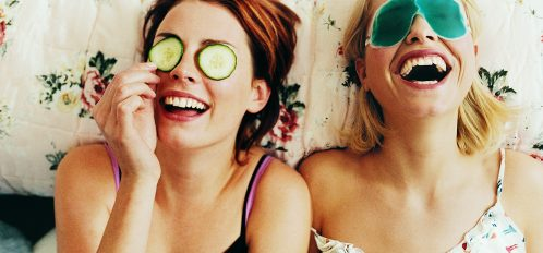 Two Women Laughing and Wearing Cucumbers Over Their Eyes at the Spa During Girlfriend Getaways Near Washington DC